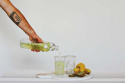 drink person pouring juice on glasses on table glass
