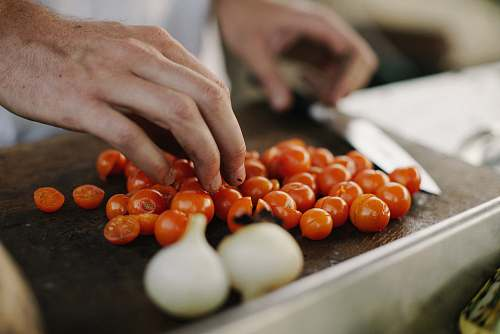vegetable person slicing cherry tomatoes produce