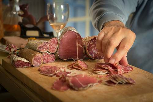 france person slicing meat glass
