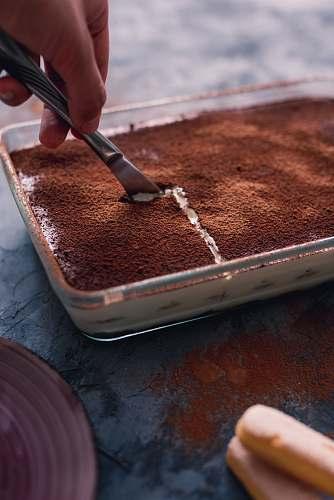 dessert person slicing pasrty chocolate