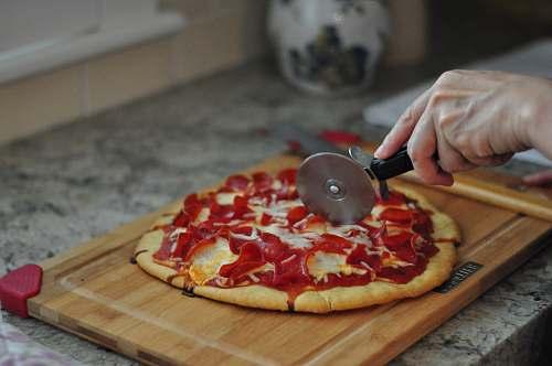 pizza person slicing pizza human