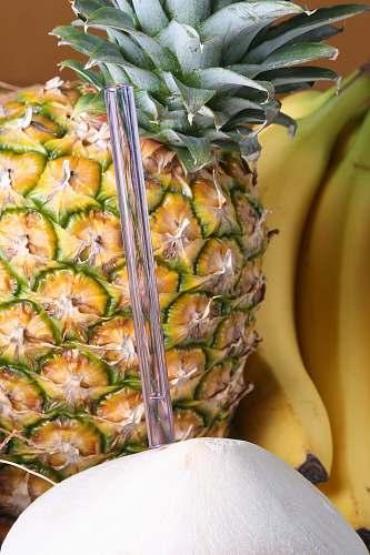fruit pineapple beside banana plant