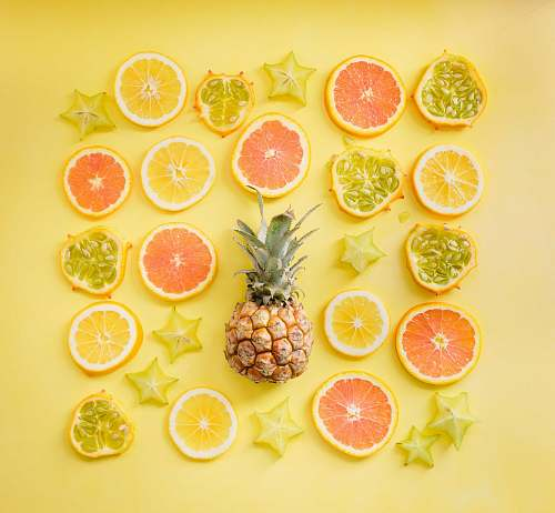fruit pineapple surrounded by citrus fruits pineapple