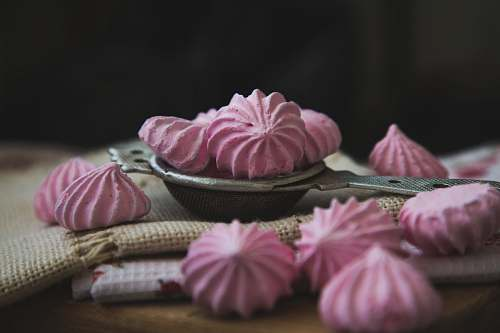 confectionery pink meringues on white textile sweets