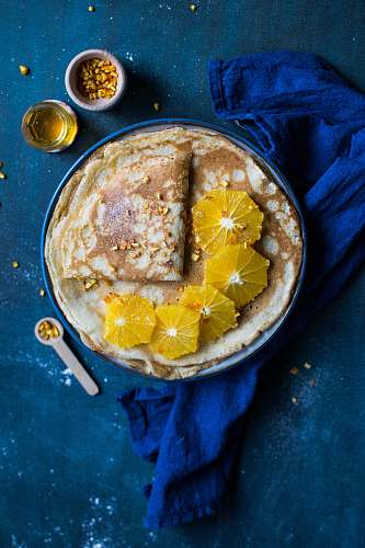 photo cornbread pita bread on blue plate beside white plastic spoon bread free for commercial use images