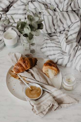 bread plate of baked bread croissant