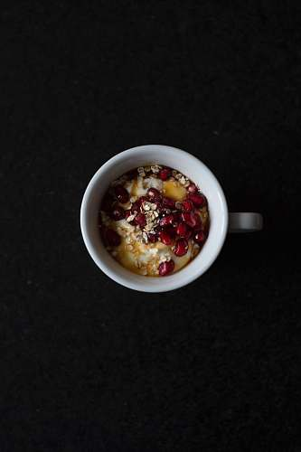 breakfast pomegranate seeds and cereals in mug oatmeal
