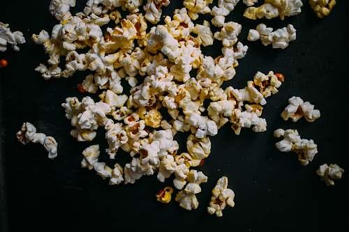 popcorn popcorn on black panel snack