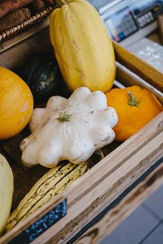 fruit pumpkins on gray wooden crate banana