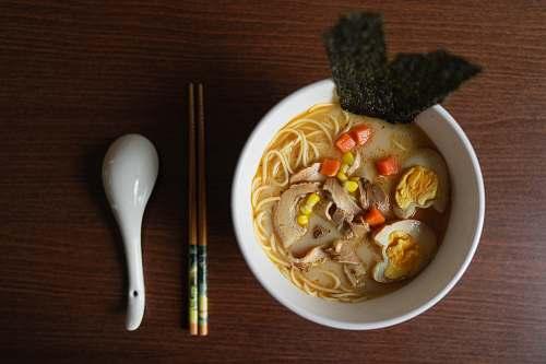bowl ramen platter beside chopsticks and ladle dish