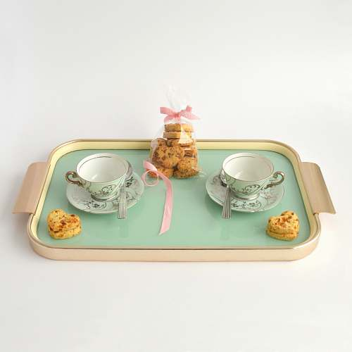 tray rectangular beige and green tea set and packed cookies tea