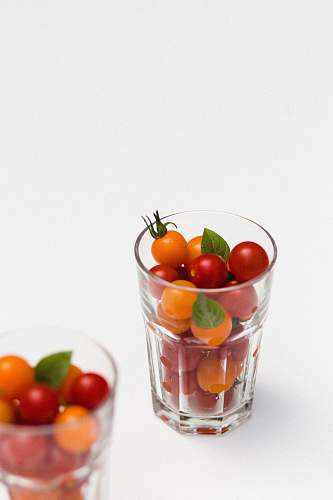 vegetable red and orange fruits in clear rock glass tomato