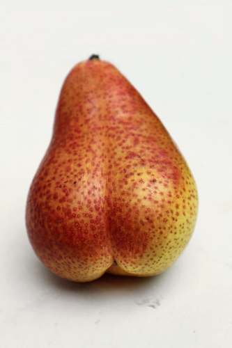 fruit red and yellow pear on white surface pear