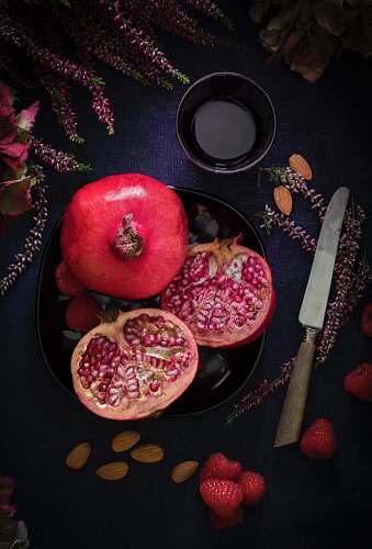 fruit red fruit on black plate flora