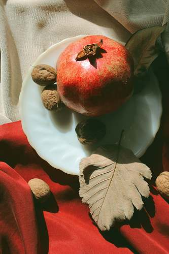 fruit red fruit on white ceramic plate apple