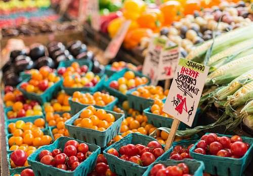 produce red tomato lot on blue baskets market