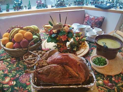 dinner roasted chicken beside basket of fruits supper