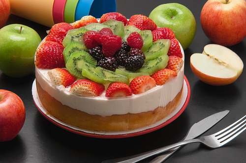 fruit round cake with assorted fruits on top apple