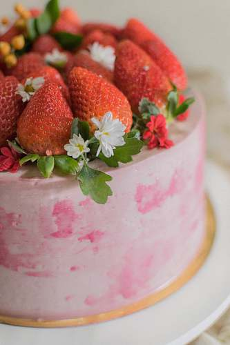 plant round cake with strawberries on top strawberry