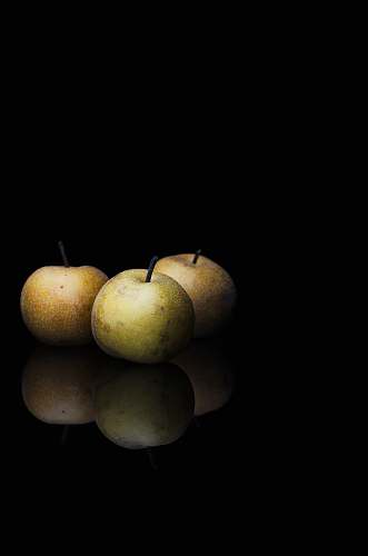 fruit round fruits in dimmed area pear