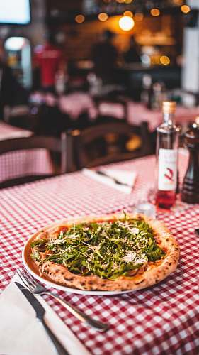 pizza round pizza with vegetable cutlery