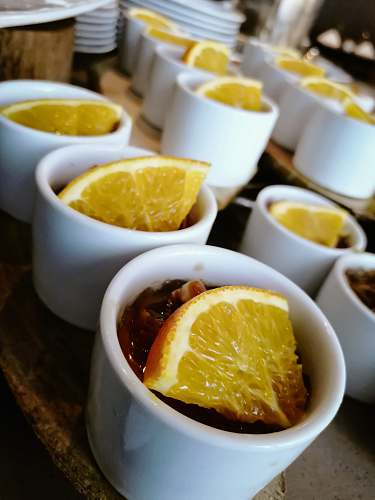 fruit round white cup with food and lemon citrus fruit