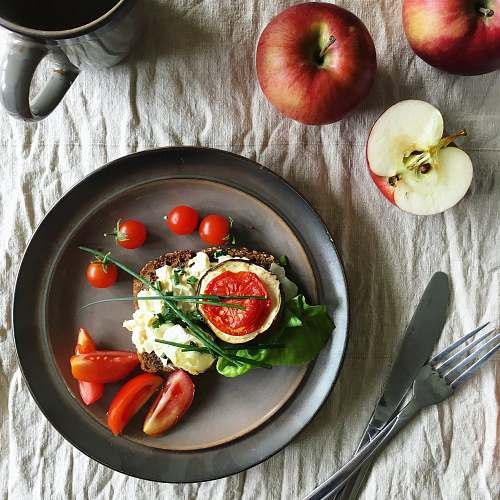 apple sandwich with cream and tomatoes on plate flora