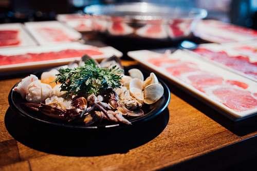 meal seafood dish on black plate dish