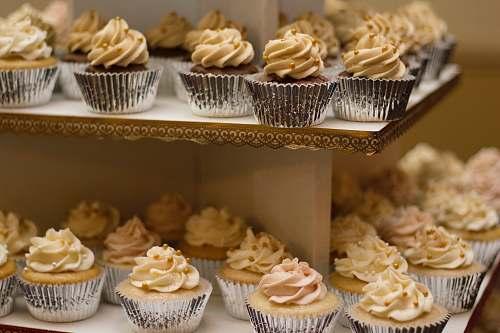 cupcake selective focus photo of 2-tiered cupcakes dessert