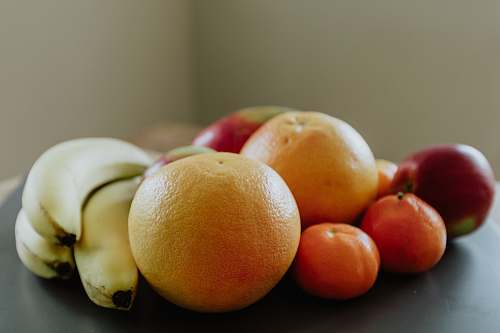 fruit selective focus photography of banana, orange, and apple fruits citrus fruit