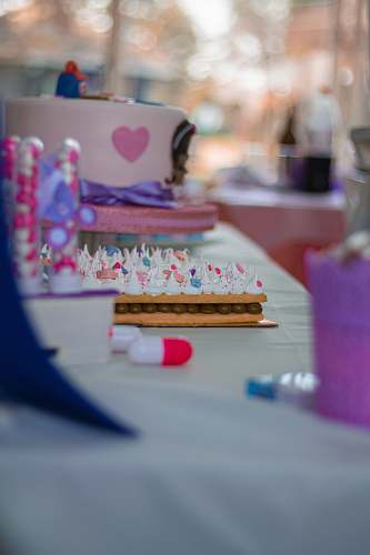 dessert selective focus photography of cake and desserts on white table cake