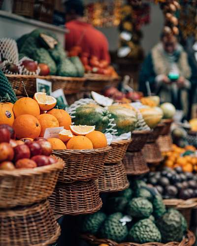 fruit selective focus photography of displayed basket of fruits citrus fruit