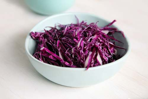vegetable selective focus photography of purple petal filled bowl bowl