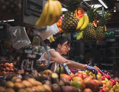 fruit selective focus photography of woman selling fruits flora