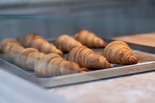 croissant seven croissant on gray metal tray bread