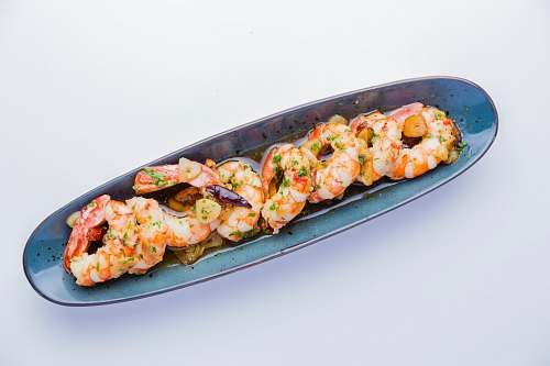 meal shrimp dish in gray oblong plate dish