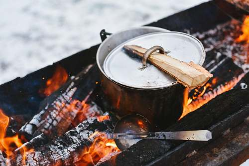 bbq silver cook pot on firewood outdoor