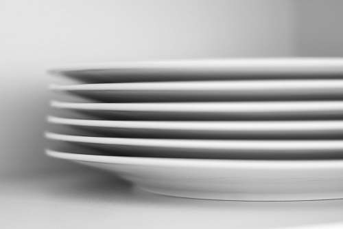 black-and-white six piled white ceramic plates dish