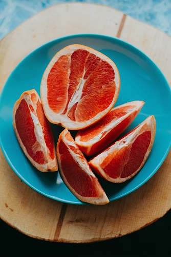 fruit slice fruits on blue plate grapefruit