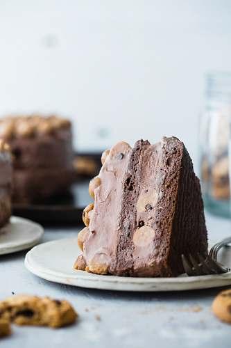 dessert slice of chocolate cake on white ceramic saucer chocolate