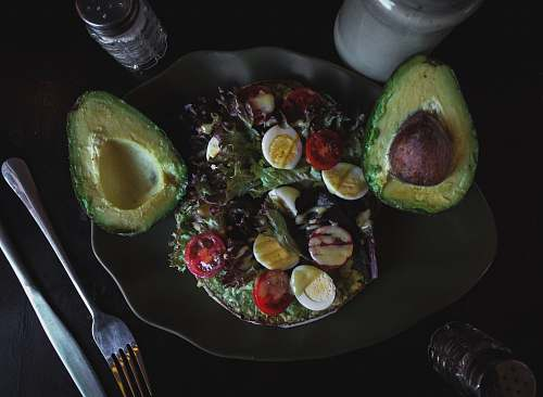 plant sliced avocado fruit and salad with eggs avocado