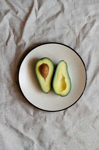 plant sliced avocado on plate fruit