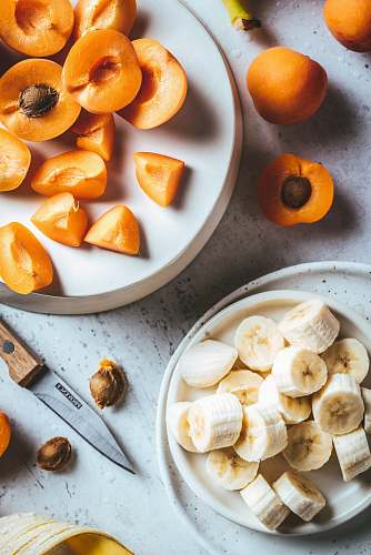 plant sliced banana fruit and peach produce