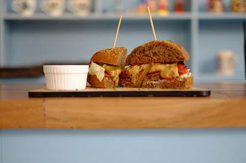 burger sliced burger on brown tray blue burger