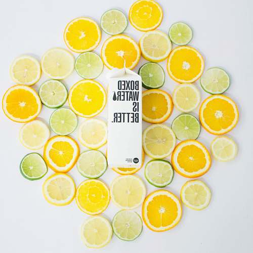plant Sliced citrus fruits and a Boxed Water carton citrus fruit
