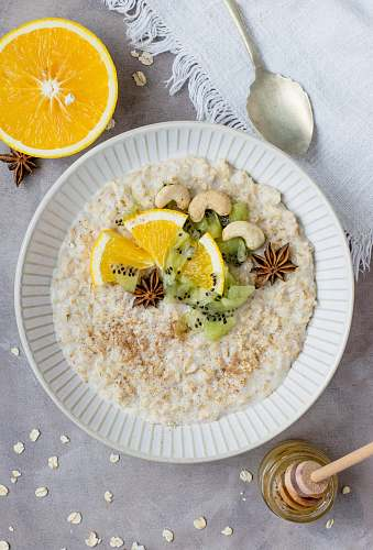 oatmeal sliced fruit and kiwi on plate flatlay