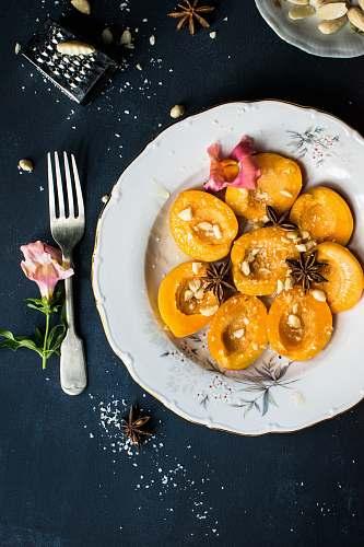 fruit sliced fruit on plate beside spoon plate