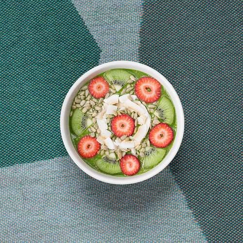 plant sliced fruits in white ceramic bowl dish