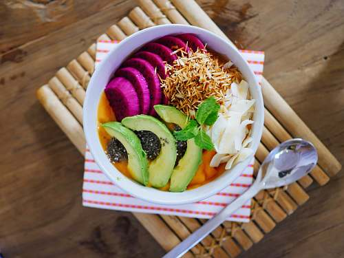 chiang mai sliced fruits on bowl beside gray spoon thailand