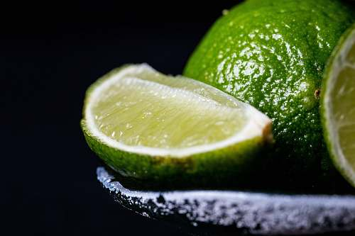 fruit sliced lime on grey bowl lime